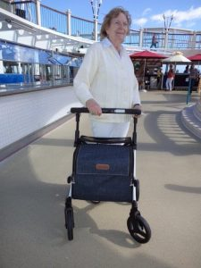 Woman enjoys traveling with a mobiity aid