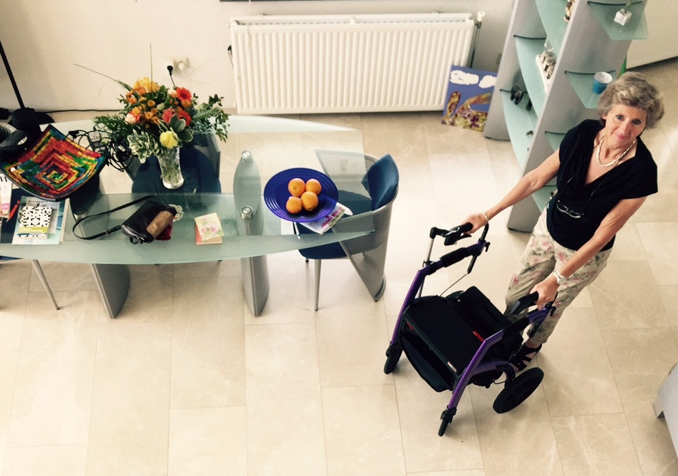 Woman using mobility aid inside the house