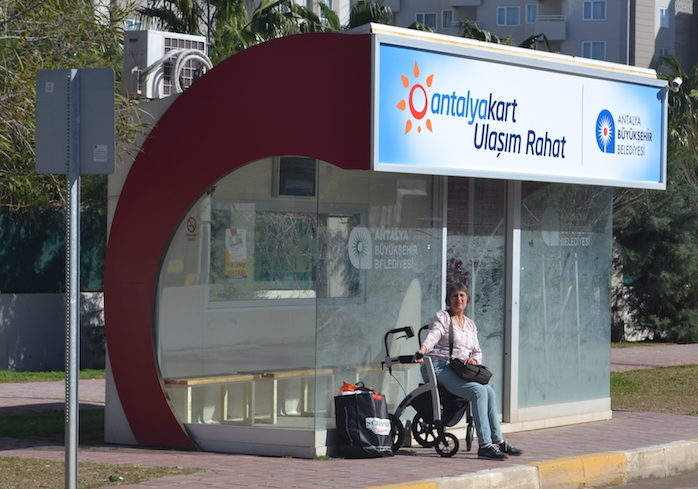 Waiting for the bus in a wheelchair