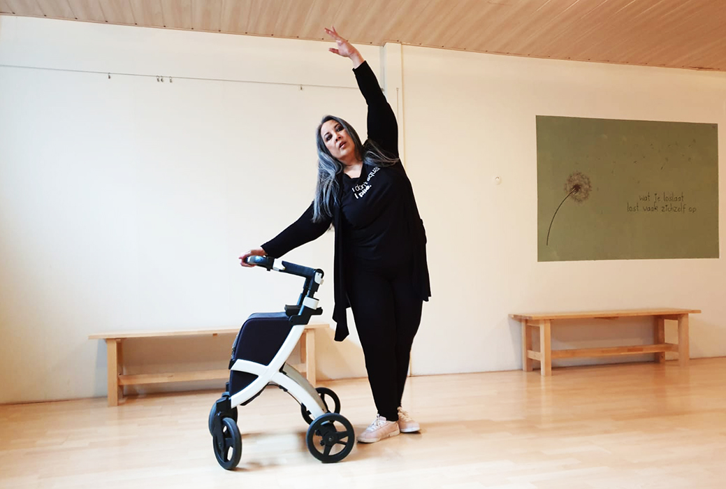 Woman dancing with a Rollz Flex rollator in her studio