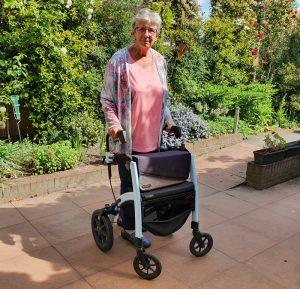 Lady using a Rollz Motion walker