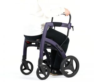 Woman showing how to sit on a rollator with seat
