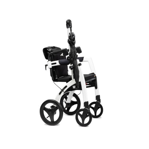 Rollz Moton umbrella folded and attached to the frame of a white rollator