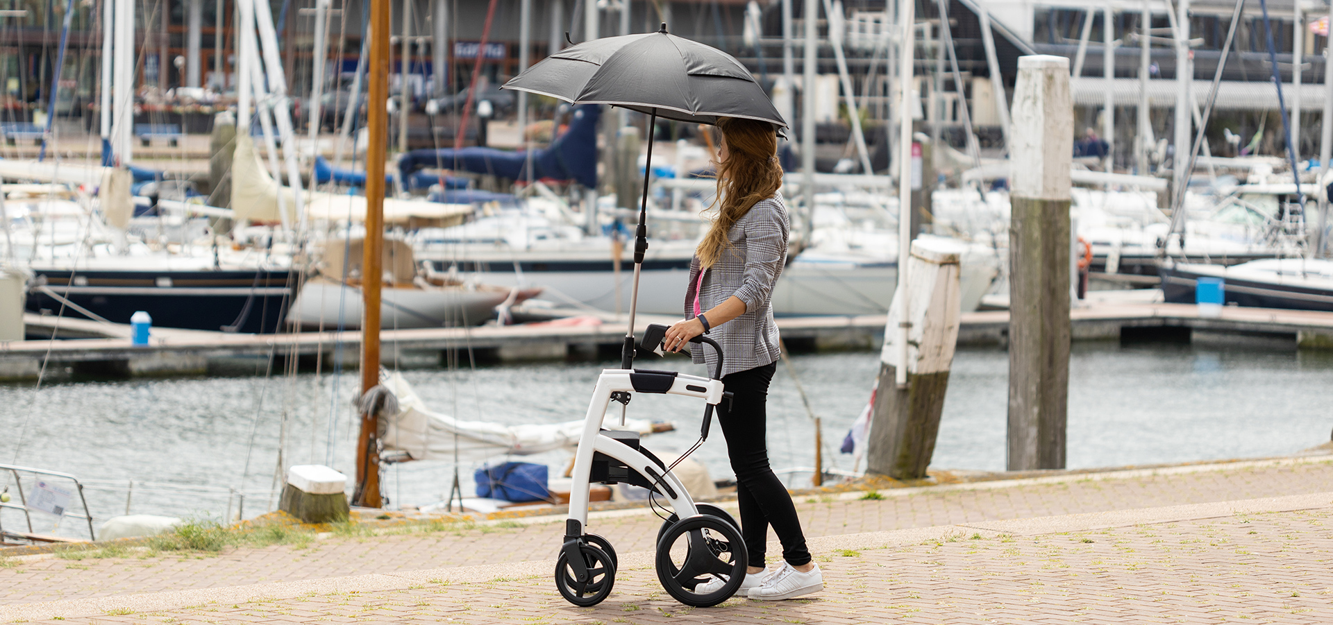 Walking upright with a Rollz Motion stable rollator and umbrella