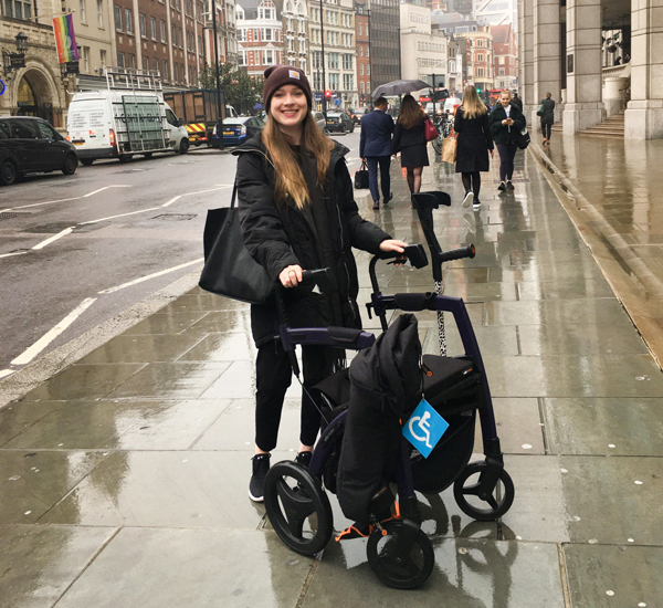 Young woman reviews her trip to London with a Rollz Motion rollator