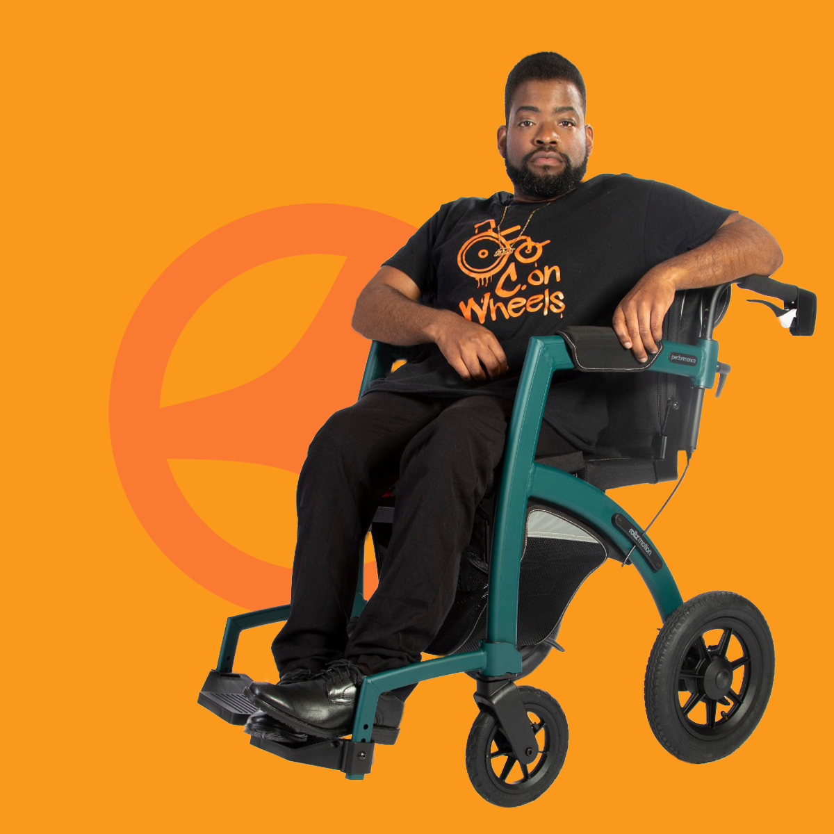 Young man sitting in a comfortable wheelchair