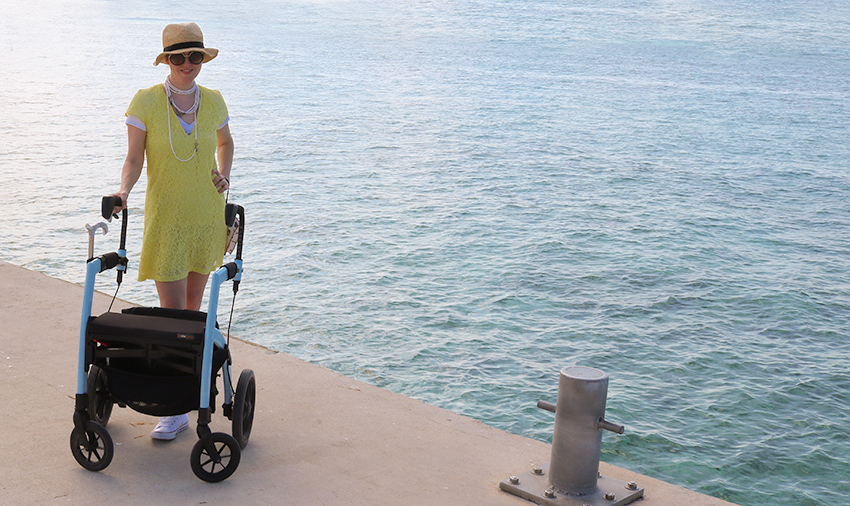 Woman with multiple sclerosis enjoying a day out with a Rollz Motion rollator