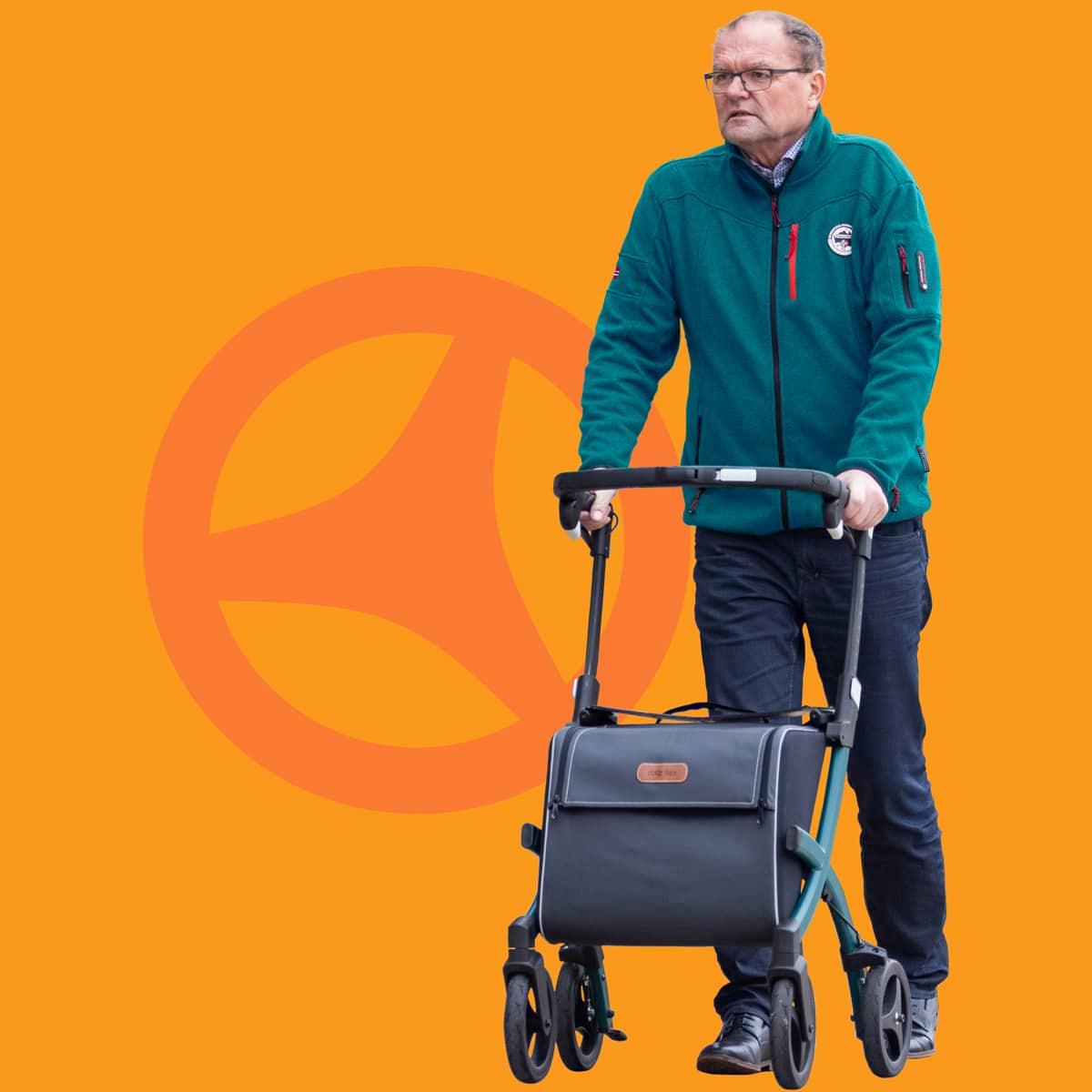 Man walking with a Rollz Flex rollator with big shopping bag
